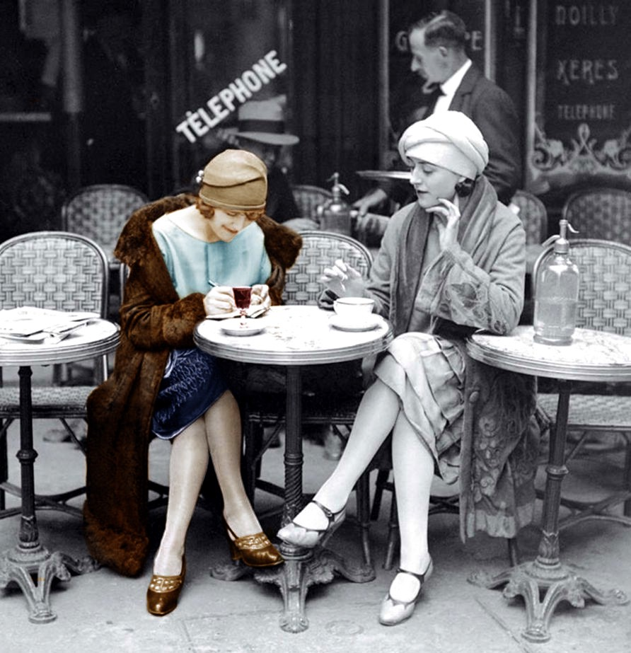 Two women sit at a Parisian café tablein the 1920s