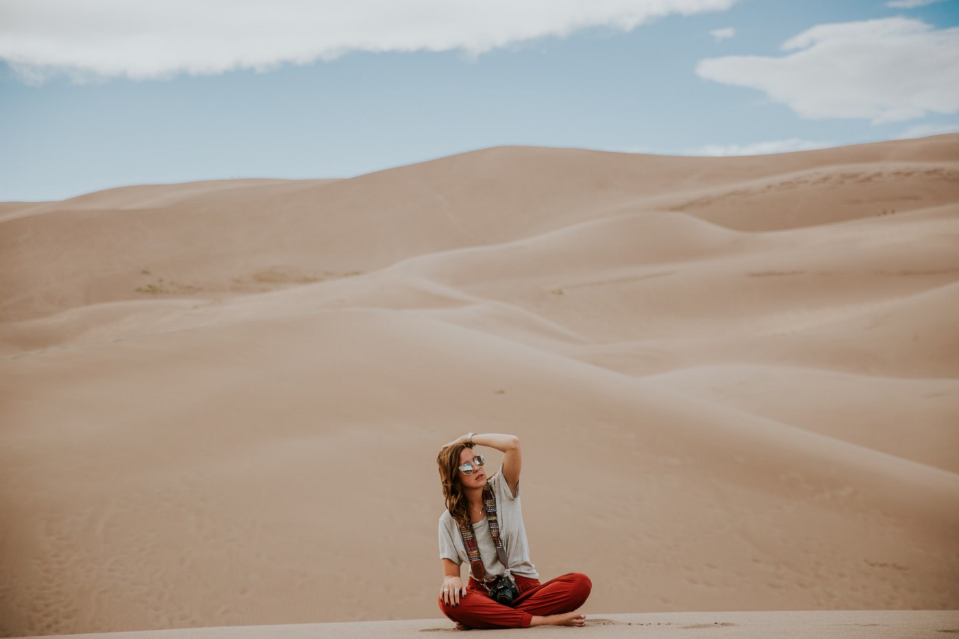 A person sitting in the sand.