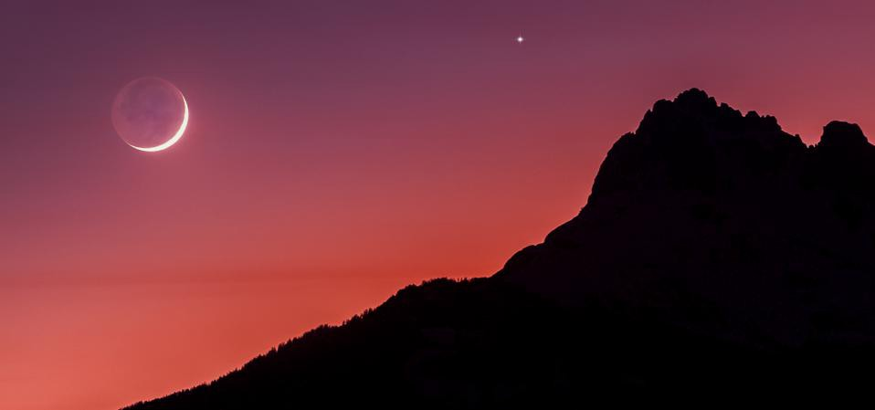 Jupiter as bright dot above crescent moon over mountaintop on Nov 17.