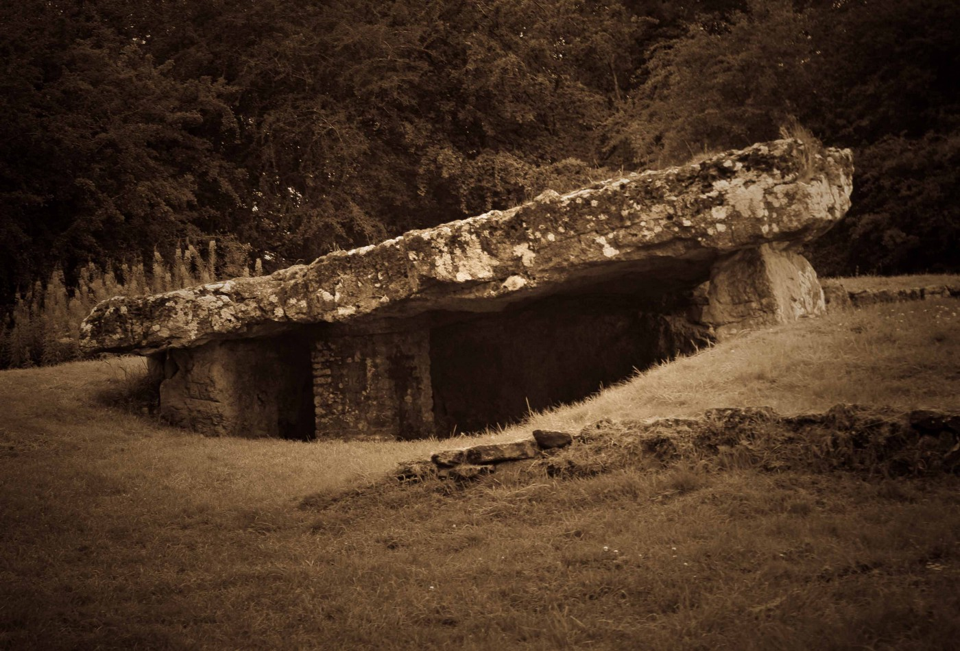 Photo of Tinkinswood Burial Chamber in sepia tones.