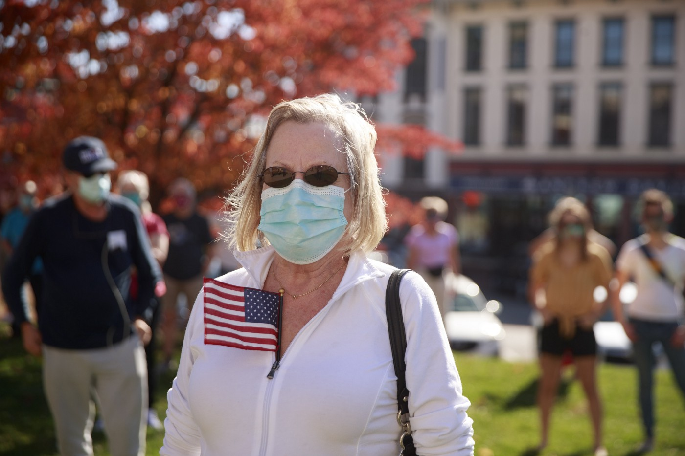 A woman seen with an American flag gathering at a Protect the Results rally at the Monroe County courthouse in Indiana