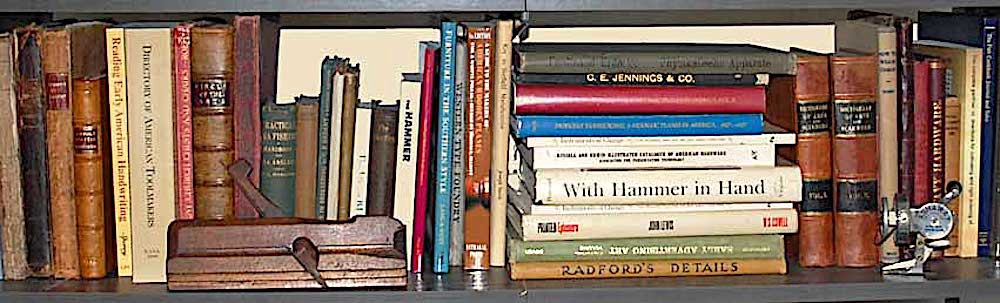 A shelf of antiquarian and reference books on traditional crafts