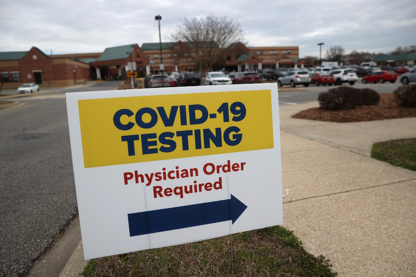 Signs directing patients to a COVID-19 virus testing drive-up location outside Medstar St. Mary's Hospital on March 17, 2020.