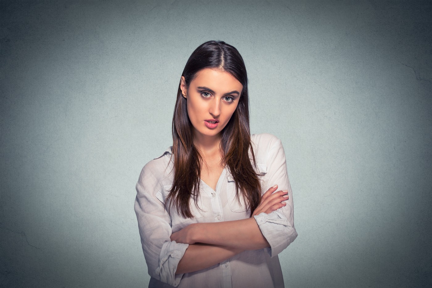 Young lady with folded arms just found out that her domestic asset protection trust is worthless.