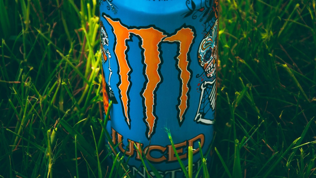 Monster can in grass