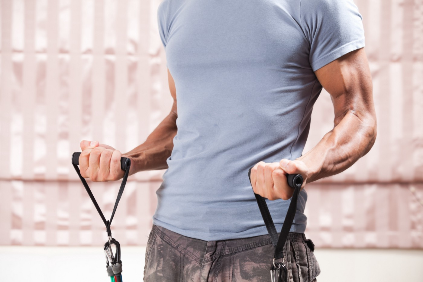 A muscular person works out.