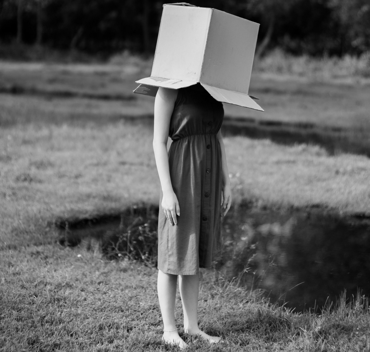 A woman with a box on her head that shows worry, anxiety, and bad habits