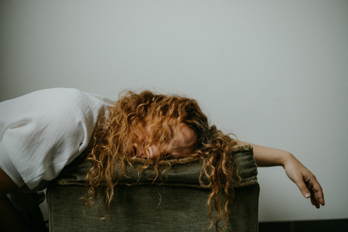 A young woman falls asleep with fatigue.