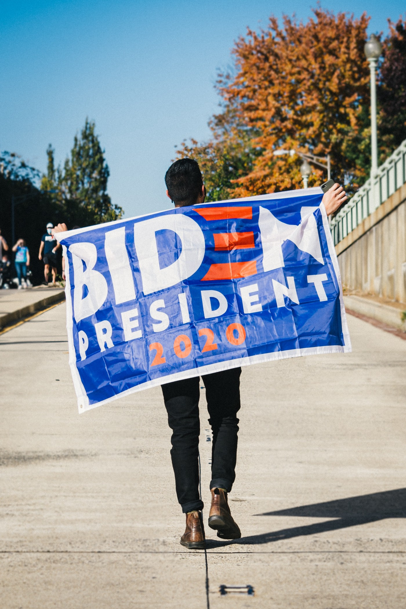 Demonstrator with a Biden for President sign