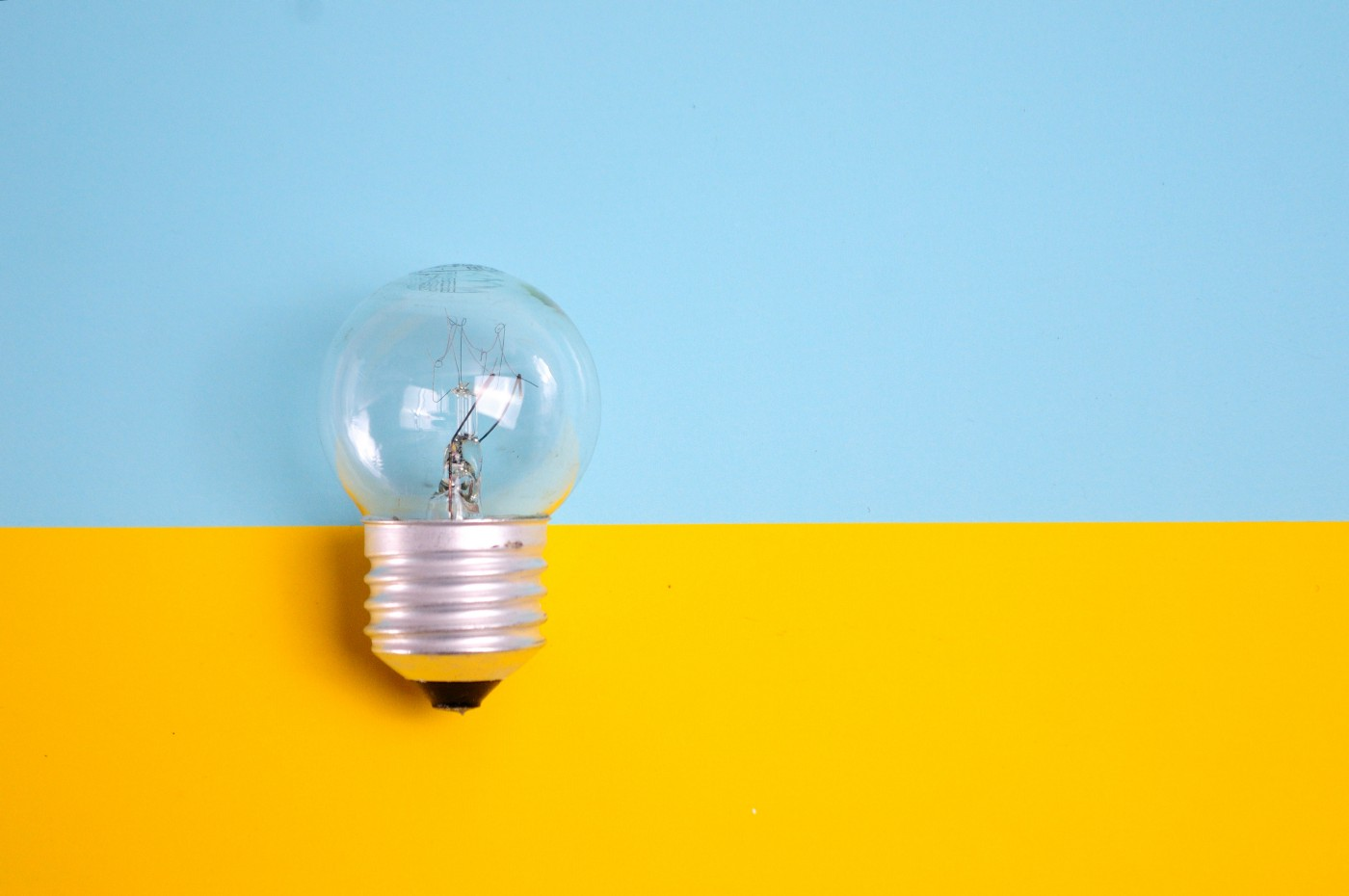 Light bulb with blue and yellow background