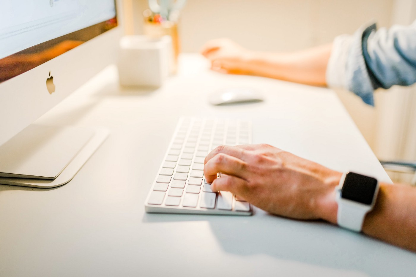 Man using a mac for his online business