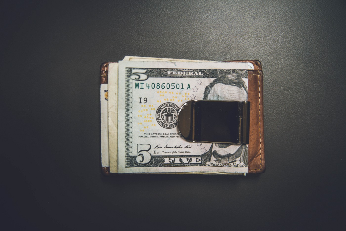 Wallet and some cash Photo by NeONBRAND on Unsplash