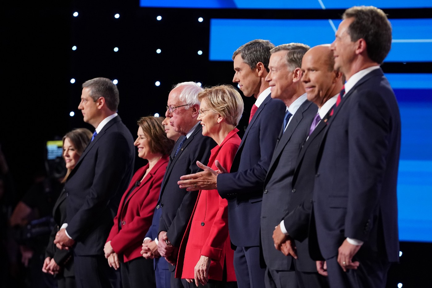 Democratic presidential candidates standing on stage at the beginning of the Democratic Presidential Debate on July 30, 2019.