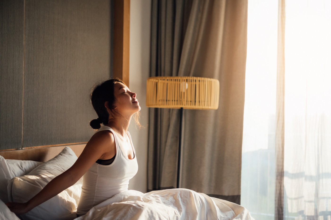 Woman getting out of bed ready to face the day.