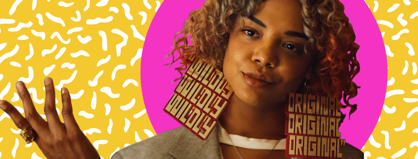 """Tessa Thompson's character """"Detroit"""" wearing earrings that state """"Wildly"""" on the left earring and """"Original"""" on the right earring."""