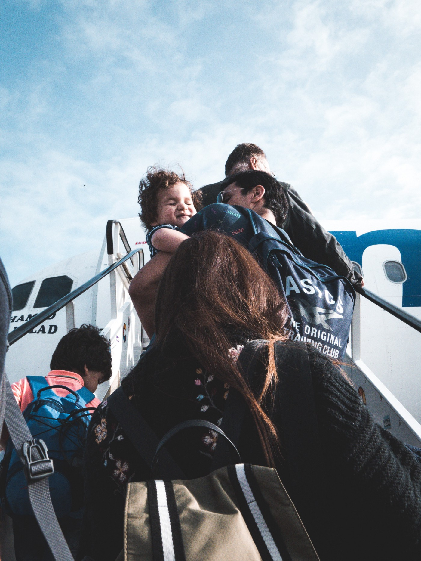 family boarding a plane, travelling with small children