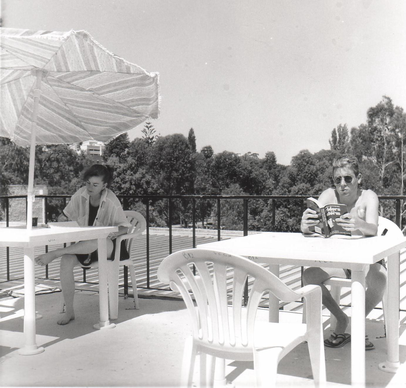 Two people sitting on a balcony