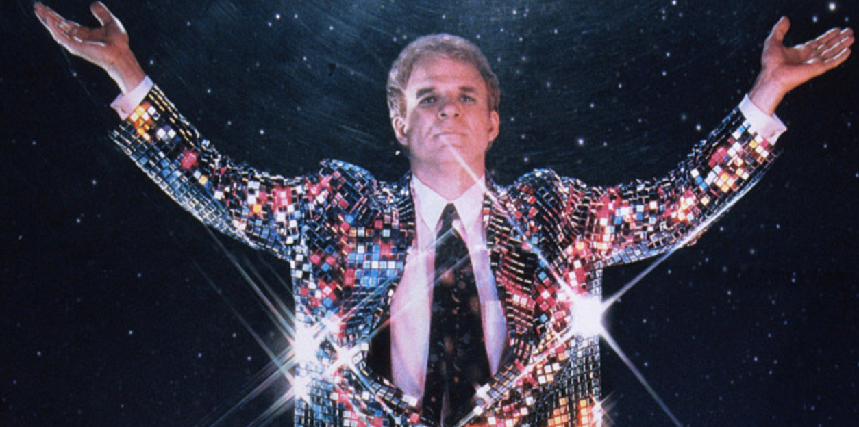 Movie Poster of Steve Martin playing an evangelist and wearing a glittery suit