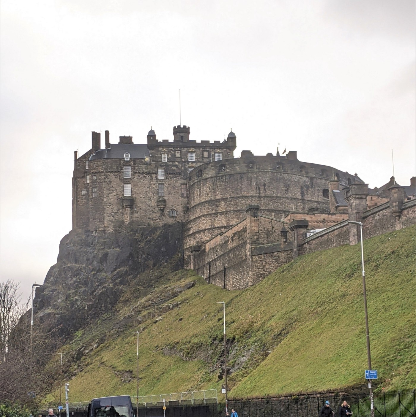 The Queen's castle in Edinburgh sits above a green hill
