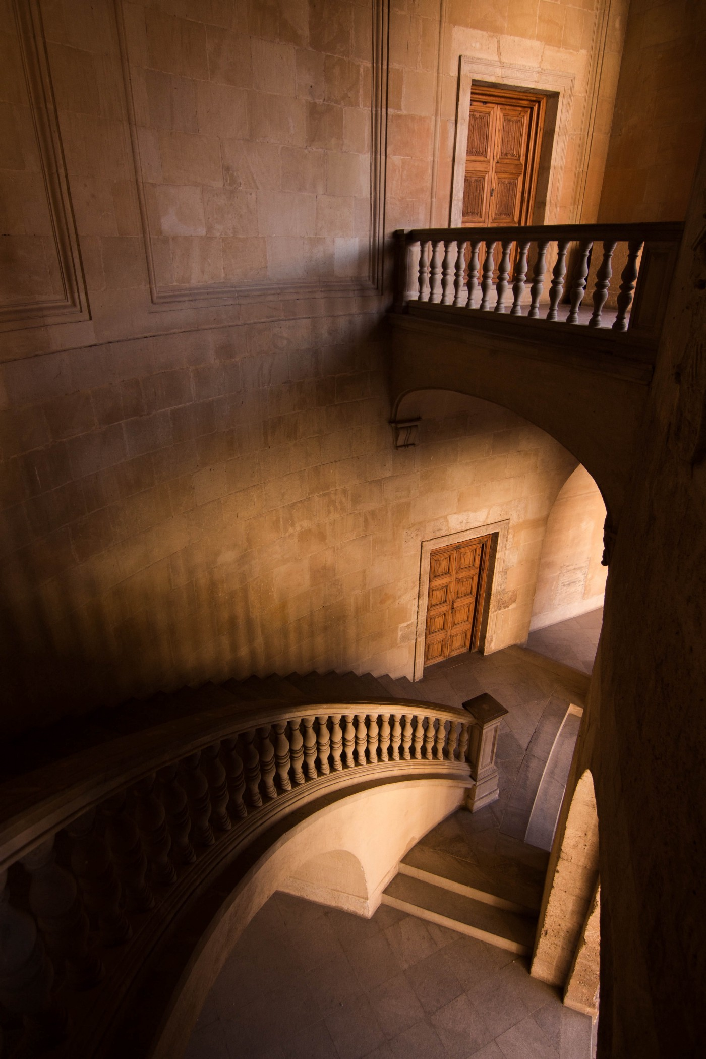 Doors on two floors with a staircase leading up to them.