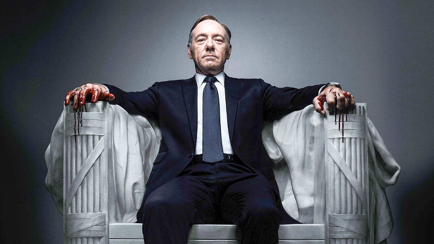 President Underwood from House of Cards sits on a stone throne