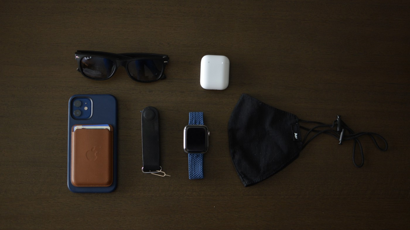 My current everday carry; Rayban Sunglasses, iPhone 12 and wallet, Distil KeyLoop, Apple Watch Series 5, Aer Mask, and Airpods.