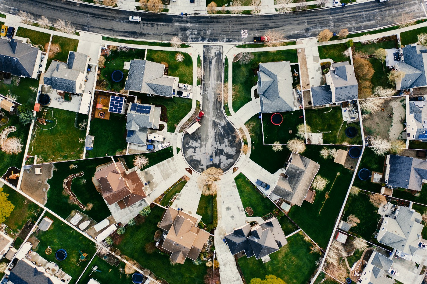 This is an aerial view of a neighborhood, showing a cluster of houses.