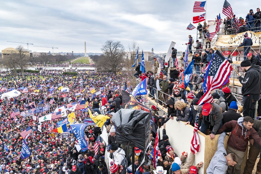 Thousands of insurrectionists scale the walls of the U.S. Capitol on Jan. 6, 2021.