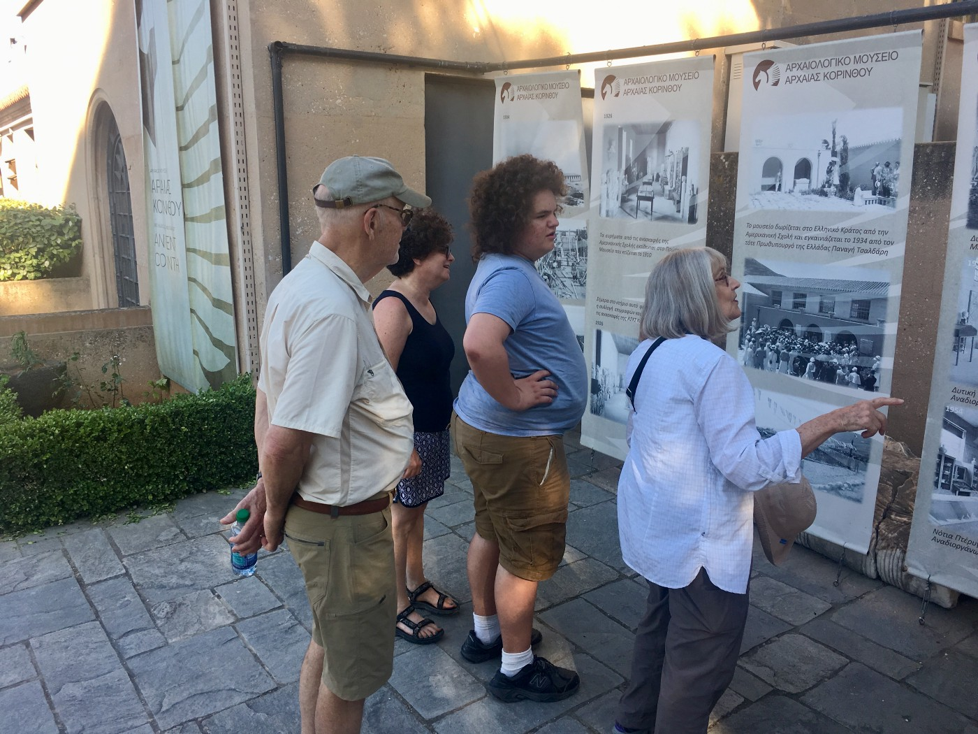 My mother leads a tour of the archaeological museum in Corinth with my father, while my wife Emily and my son Joshua listen
