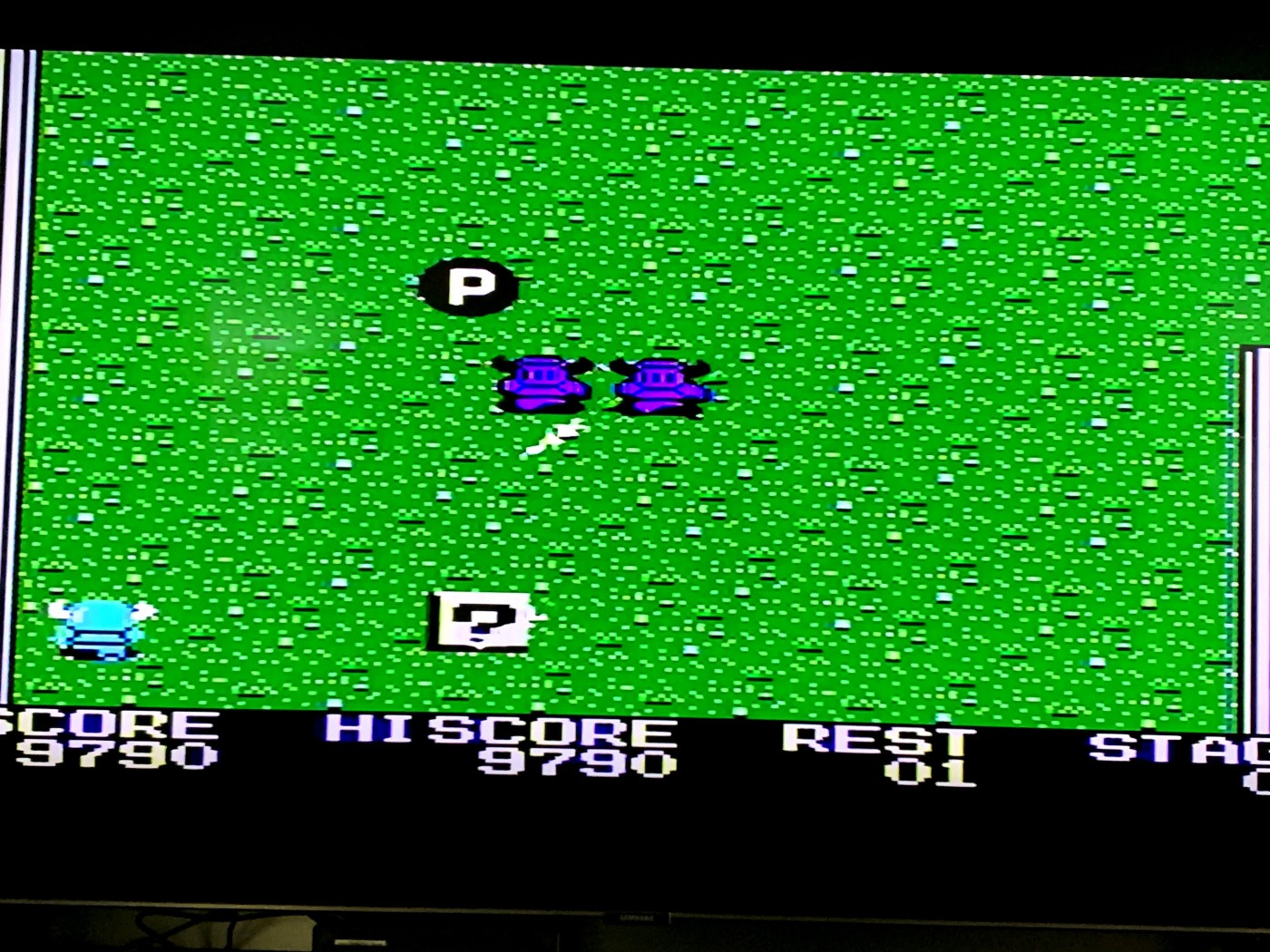 A scene from a classic video game where a knight is being attacked by two guards.