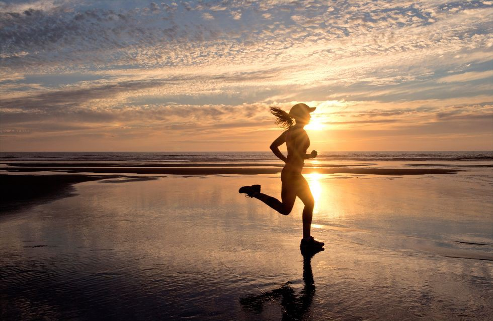 woman running on beach in the morning, runner's high