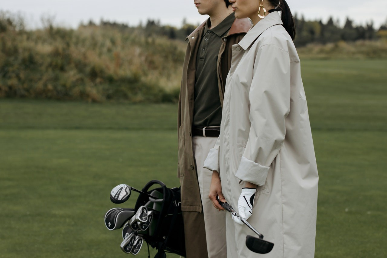 a couple wearing golf clothes