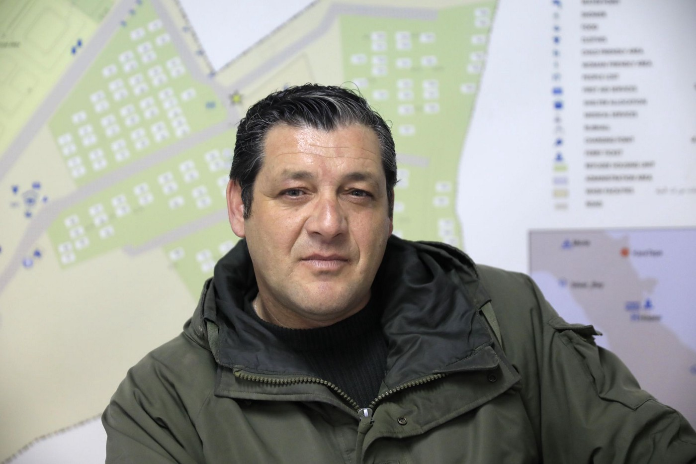 """Stavros Mirogiannis, Director of the Kara Tepe """"village"""" in his office."""