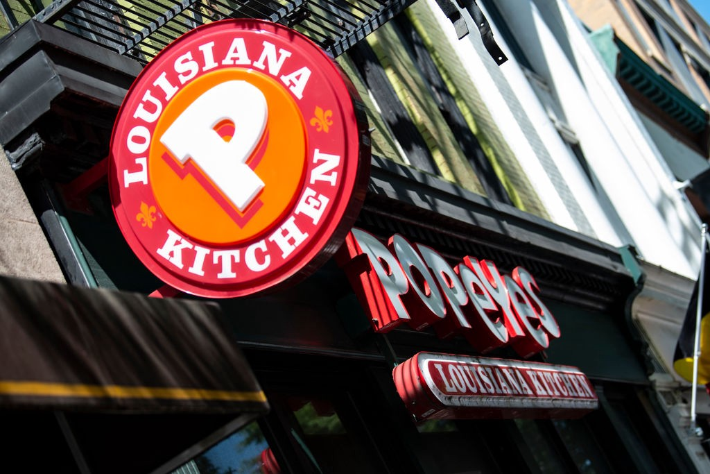 A photo of a Popeyes store front and logo.