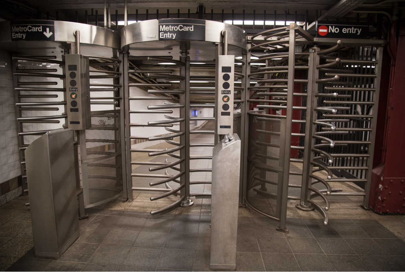 subway turnstyles with curved metal gates
