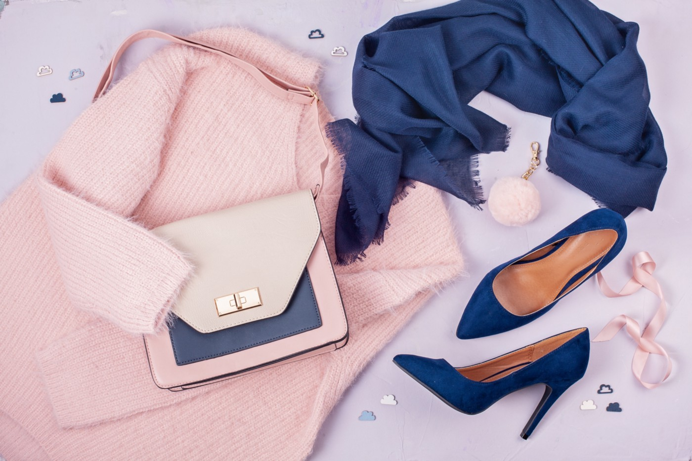 Blue high heels, pink jacket, and pink purse, viewed from above