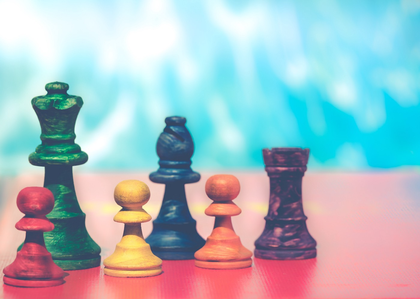 Colorful chess pieces.
