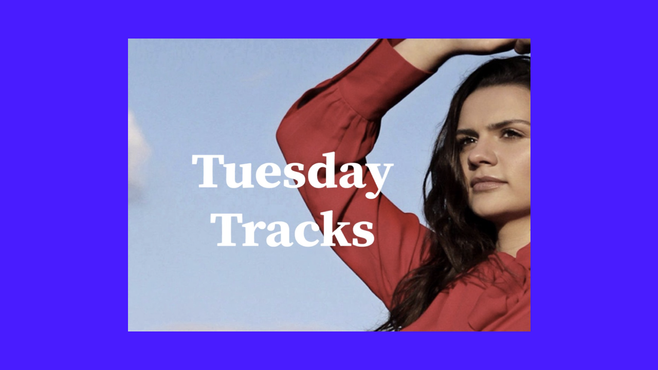 """A picture of Sirena Maré against a blue sky with the text """"Tuesday Tracks"""" collaged over a solid purple background."""