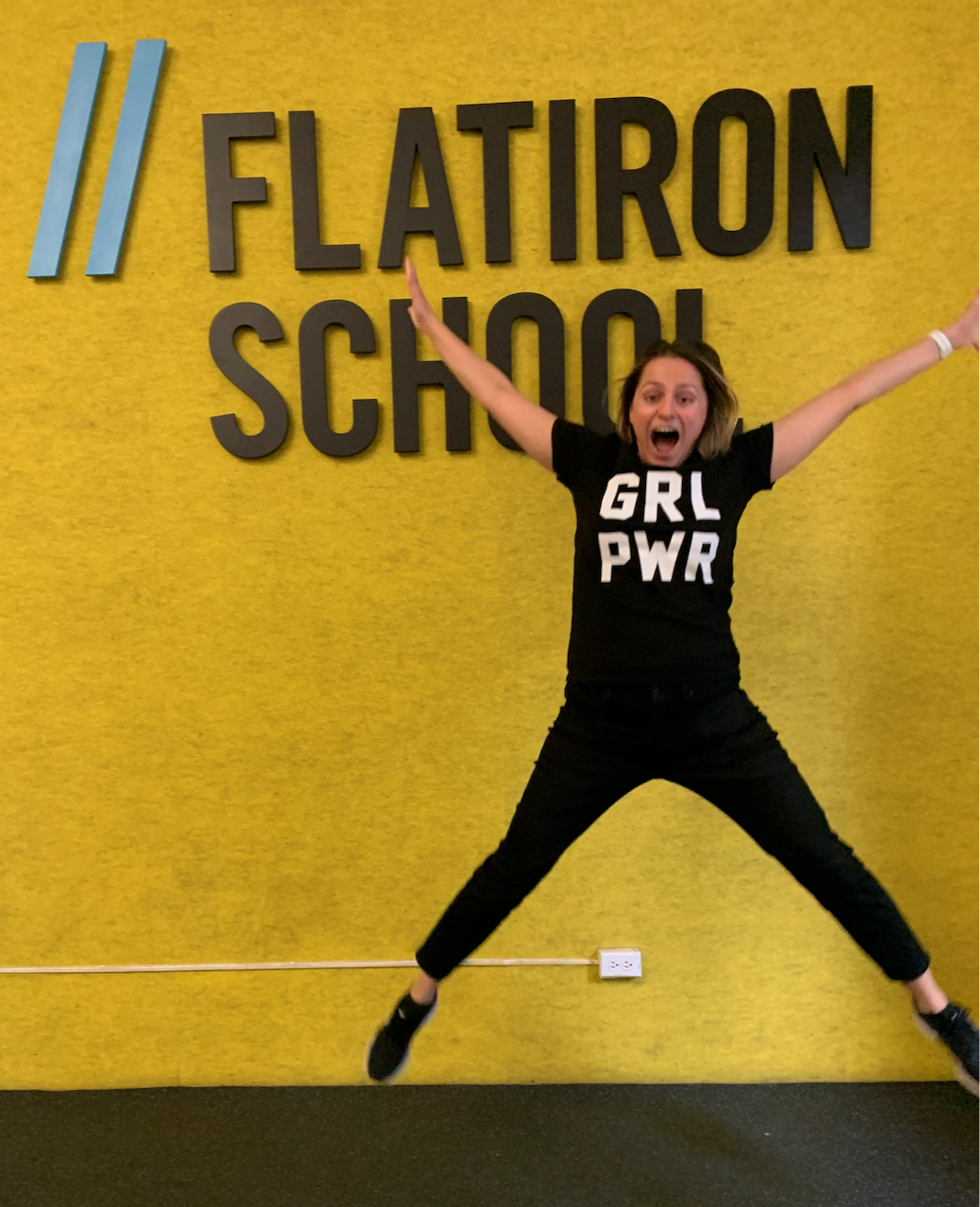 Jumping with excitement after graduating Flatiron School