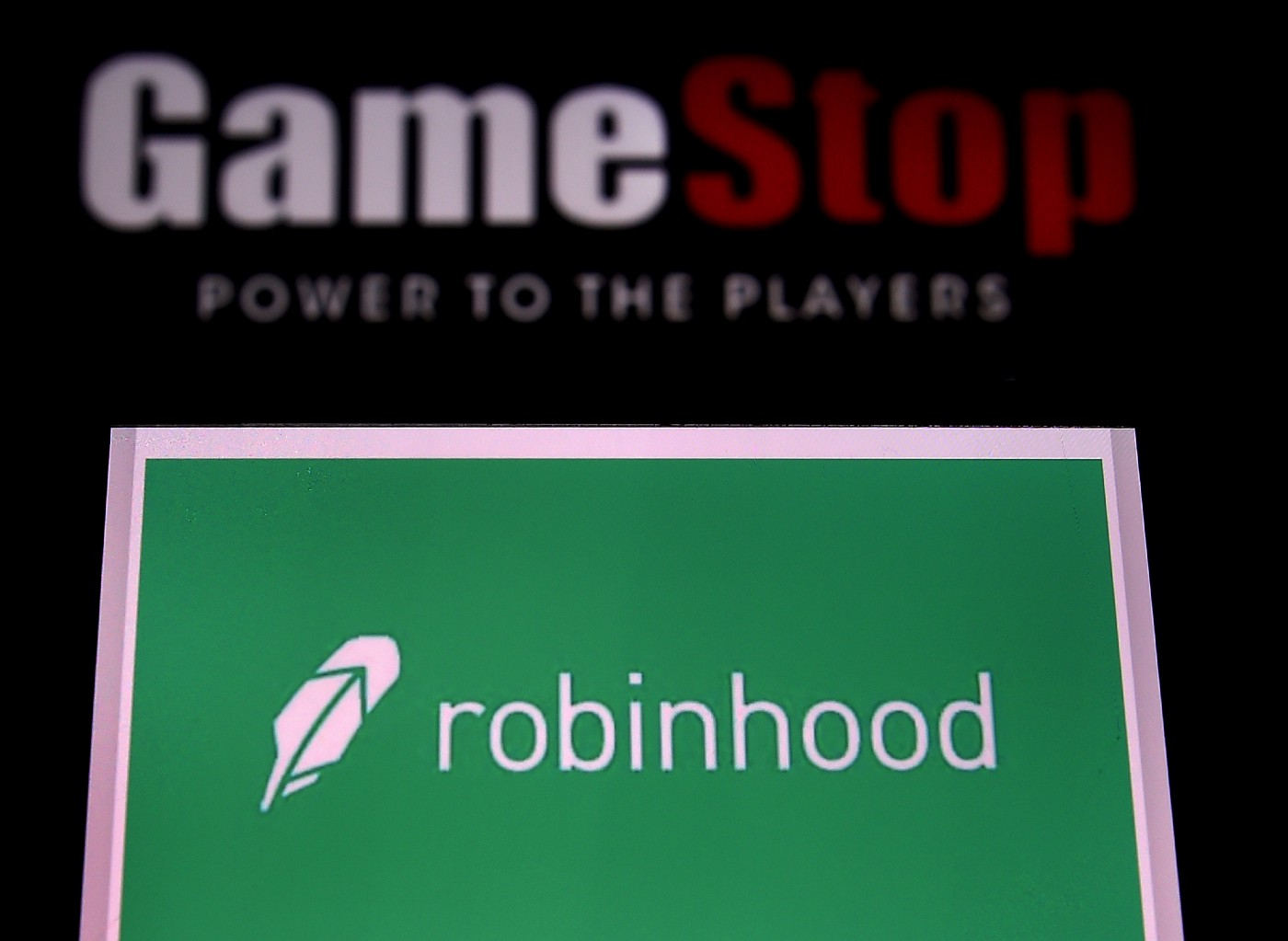 This photo illustration shows the logos of videogame retail store GameStop and trading application Robinhood on a computer