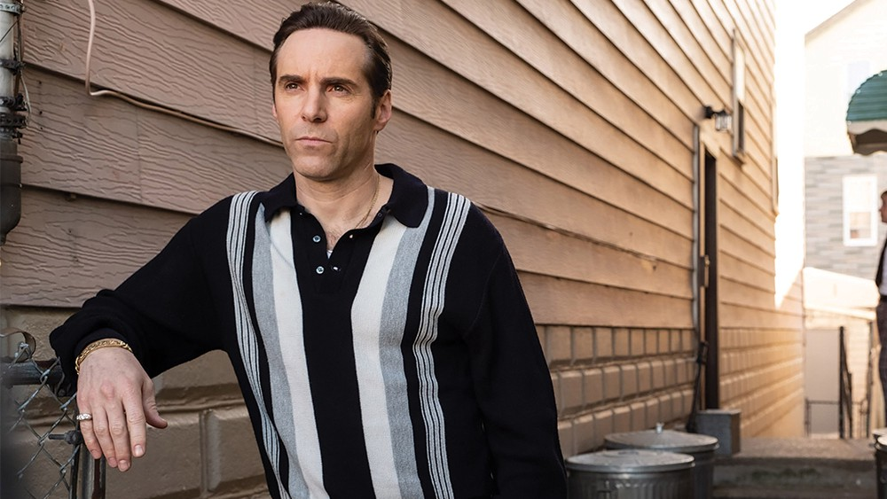 Alessandro Nivola as Dickie Moltisanti, standing at the house.
