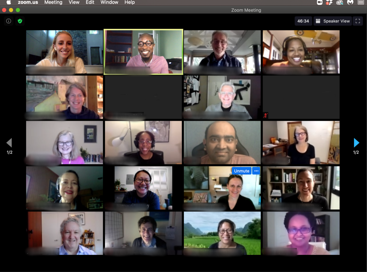 screen shot of a Zoom room with smiling faces