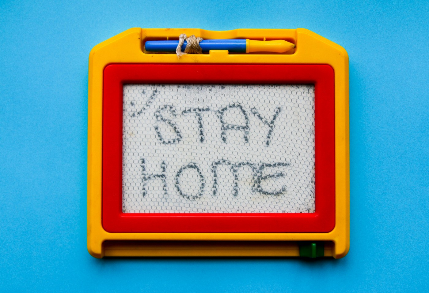 Child's magnetic board showing 'Stay Home'