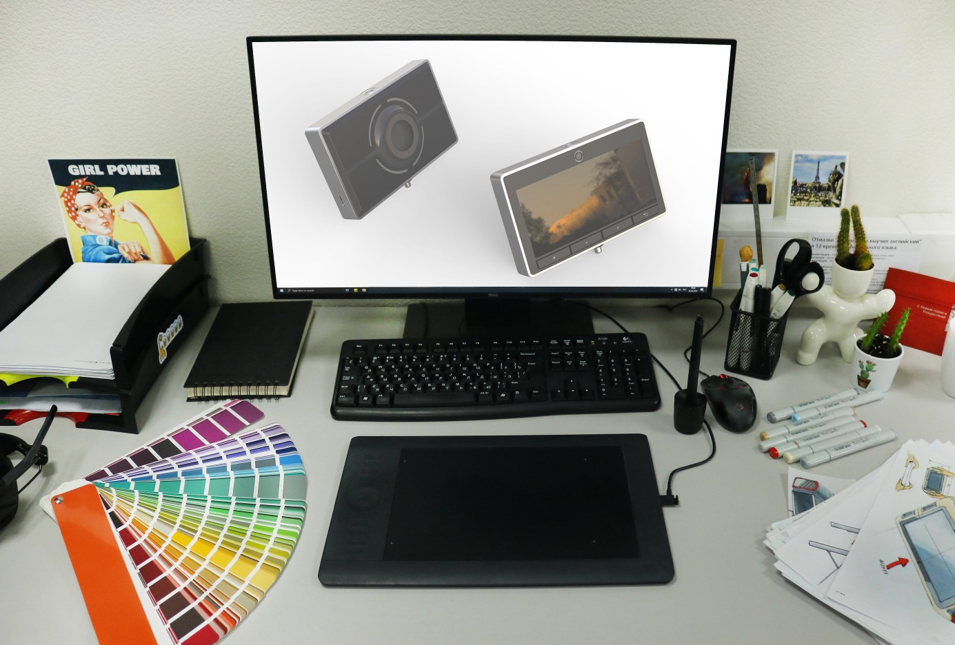 A workplace of our industrial designer: a tablet and a computer with 3D models of a new device.