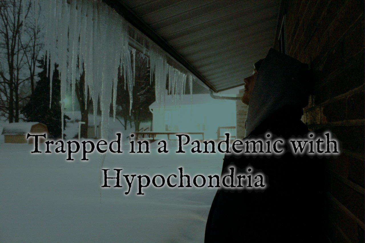 Man staring at icicles during winter, text overlaying reading trapped in a pandemic with hypochondria