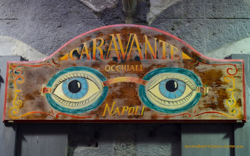 A street sign for an optometrist in Naples
