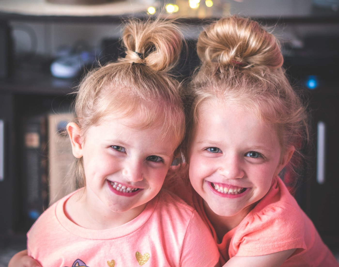 Photo of 2 smiling young girls.