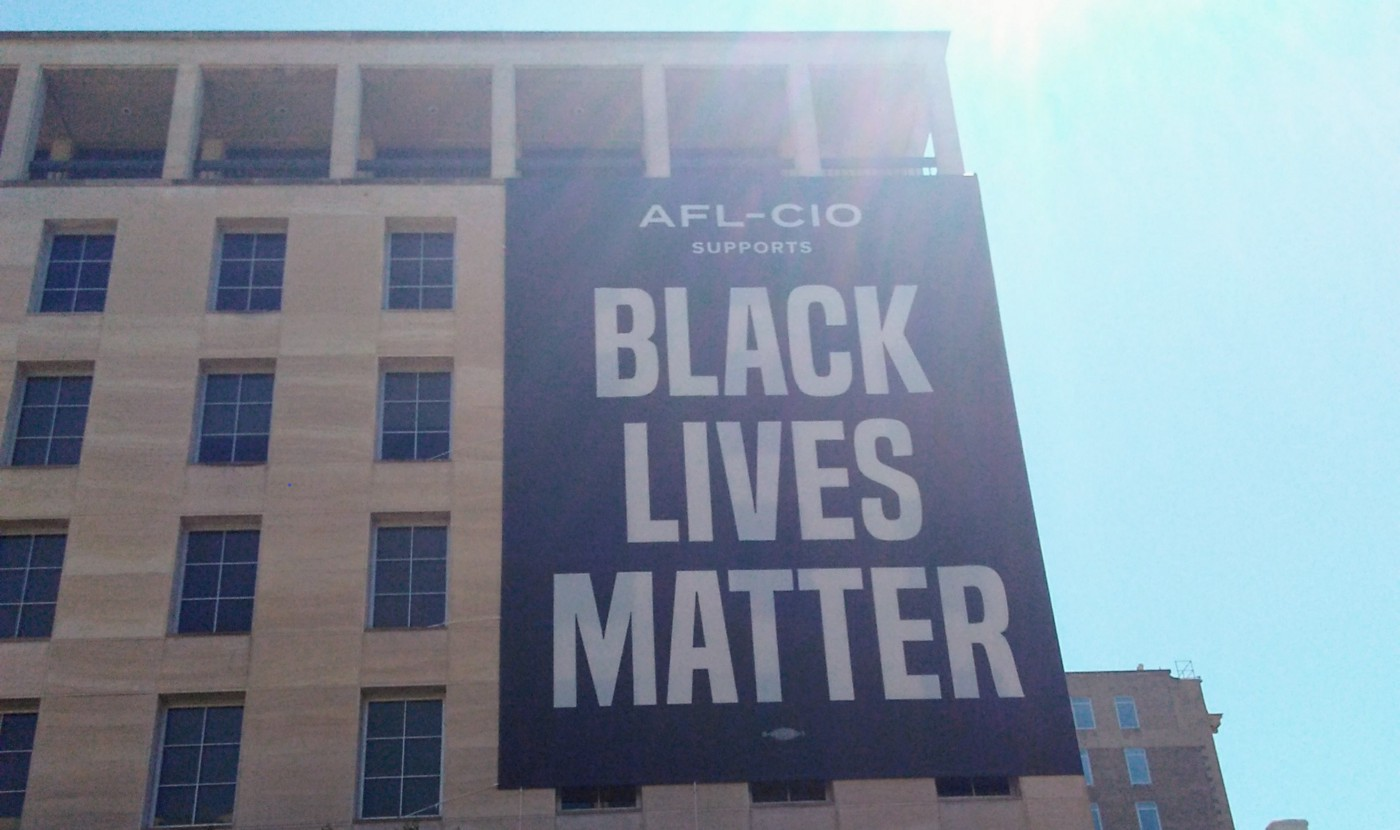 Photo of a Black Lives Matter banner on a building