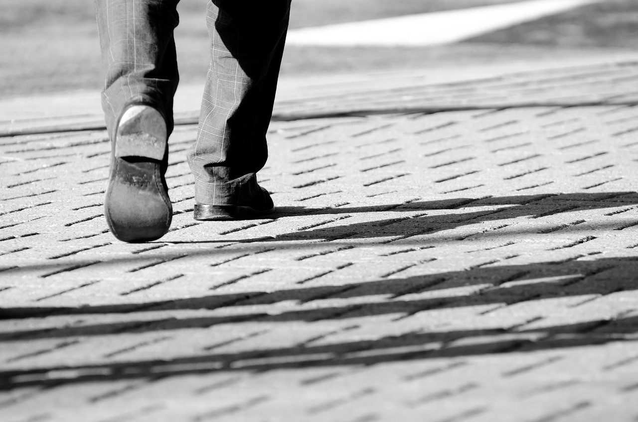 A man walking step by step.