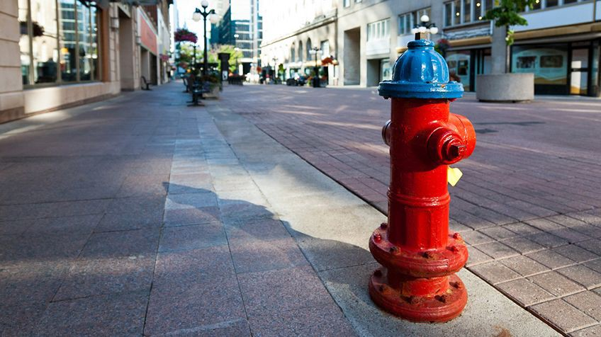 A fire hydrant on side of the street — sample image used for testing.